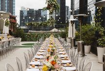 LTL EVENT | LAUREN & JONNO / On a magical November afternoon atop a Melbourne rooftop, the beautiful Lauren and Jonno said 'I do' in front of an intimate group friends and family. Overhead floral installations set against the city skyscrapers created the perfect juxtaposition of classic styling meets urban laneway. | Photography: Abigail Varney | Flowers: Bud Flowers | Furniture: Dann Event Hire