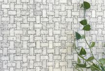 Bianco Carrara & Bargidlio Micro Mosaic Waterjet Basketweave / Bianco Carrara & Bargidlio Micro Mosaic Waterjet Basketweave is our new Basket weave design that mixes new and old and adds extra detail with micro mosaics surrounding the bigger pieces of marble. Our new take on the basket weave design is a good addition for both modern and traditional spaces and the soft colors of Bianco Carrara and Bardiglio work extremely well together. You can use this on floors or walls and it is recommended for residential and light commercial traffic.