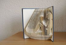 folded  and altered books / libri piegati o tagliati x farne sculture o addobbi