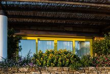 Borgo la Pietraia Country house Photogallary / Dalla natura selvaggia di una collina incontaminata, dal rosso e il blu del mare al tramonto, dalla mano esperta di un abile architetto nasce Borgo la Pietraia.