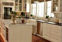 kitchen marble island with dark perimeter countertops