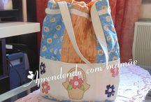 bolsa em patchwork / Tecidos de algodão, com apliquê e bolsos externos. Gráficos disponibilizados no meu blog, acesse aqui: http://www.aprendendocommamae.blogspot.com.br/