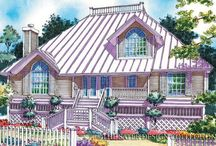 Vacation Home Plans - The Sater Design Collection / Vacation style home plans evoke a casual and relaxed atmosphere. Whether on a lakeshore, river front, or a remote rural setting, these home plans are designed to capture views and make its owners feel like they are immersed in their outdoor setting. The exteriors may have lap siding with standing seam metal roofs reflecting a true cottage style. Most of our plans are open, airy and feature casual layouts that complement the relaxed living that is desired in such vacation style homes.