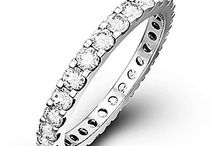 Diamond Eternity Rings / A splendid circle of sparkling diamonds, an eternity ring is more than just a ring. Our bespoke collection of beautifully designed platinum and gold eternity rings is the perfect way to say you'll love her forever...