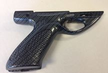 Guns & hunting accessories / Custom hydro dipped guns, bows and other hunting accessories.