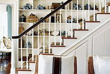 stairs and decorating the walls beside them.