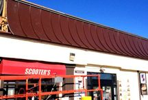 Structural Metal Roofing System / The installation of a Structural metal mall roof and standing seam facade. Curved metal roofing panel design.