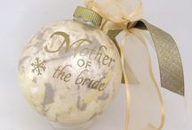 Wedding and Bridal Personalized Ornaments / The look, style and colors of a wedding invitation on to a personalized glass Christmas ornament is sure to be the most unique and remembered gift the bride and groom receive. From Snowflake Ornament Company.