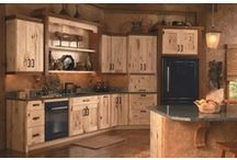 Warm Hideaway / The warm, country feel of Holbrook evokes the feeling and appeal of a cabin hideaway. A decorative range hood, along with the character of rustic maple, add to the handcrafted feel in this kitchen.