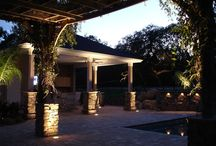 Waterfall Rock Wall Design / This Ponte Vedra Beach, FL home had a backyard with nothing but grass. 5 Star Outdoor Design custom built a pool and beautiful rock wall that look like something you would see at a resort. The patio pavers and the stacked stone wrapped pillars really add to the grand affect of this space and the night lighting make it that much more rich.