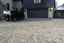 Modern Cobbles  / Modern Cobbles by Stone Event bring old world charm to this modern residence and horse stable.