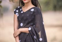 Black Forest Black Pure Silk-Chiffon Embroidered Saree / PRICE INR 7,999/- US$ 121.00 Click here https://www.eastandgrace.com/products/black-forest-pure-silk-chiffon-saree Featuring the Black Forest, pure silk-chiffon saree with dainty, white organza, hand-crafted, white poppies. The blouse is also decorated with poppies. The saree comes with an unstitched, embroidered blouse material and an unstitched matching lycra-satin petticoat fabric. Reach us:care@eastandgrace.com