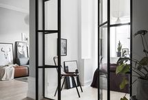 Groundfloor / Stylish, simple, light floor, eucaluptus, black furnitures and lightgrey walls. Less is more.