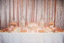 Copper Candy Bar / The warm shimmer of the copper sequined backdrop set the scene for this Copper & White Candy Bar. The contrast of crisp whites mixed with the warming tones of copper and gold, made for a visual treat. Deliciously decadent candy was packaged into individual portions so that guests could take a sweet treat away with them with ease.  Custom  graphics were used to carry through the theme with beautifully wrapped chocolates and individually designed candy labels.