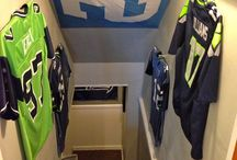 Seattle Seahawks / Seattle Seahawks displayed using the Ultra Mount Jersey Hanger. A great affordable alternative to jersey frames.