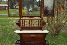 """Late 1800's Eastlake Walnut Marble Top Shaving Stand / This piece is amazing and rare. Made of solid walnut and the wood is in excellent condition. Single drawer with dove tailed construction over a 2 shelf cabinet. Bi-fold mirrors that close completely when not needed. Beautiful marble top. Fine hand carved details. There is one small repair on a side shelf. This is barely noticeable. Items like these come your way once in a lifetime. Don't miss your chance to own this stunning piece.  Measures 74"""" tall x 30"""" wide x 14"""" deep."""