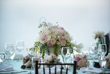 Wedding flowers. / Center pieces, cake, decoration, bouquets, boutonnieres, favors, flowers are everywhere in a wedding!