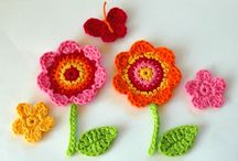 crochet flowers with stems and leaves