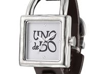 Uno de 50 / Uno de 50 Jewelry is tasteful, but with in reach and won't break the bank.  Alloy line that is inexpensive jewelry, but upscale compared to costume.  Modern designs, antique, contemporary, fancy, lab created stones.