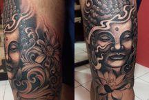 Budha face tattoo