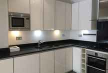 Alno Designer Handleless German Kitchen with Glass Units & Granite Worktops