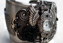 <3 Steampunk / I've become slightly obsessive over steampunk items. The style is a combination of things that I love. Classy psuedo-historical, Victorian era,  (and/or airship pirate ) inspired fashion and jewelry along with a lot of gadgety items. Using locks, keys,  gears, watch movements, clock hands, hearts, lace, leather, and lots more, modern items are revamped and made  to appear as period pieces. / by Tarika Francis