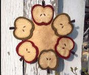felt,penny rugs,ornaments etc. / by Diane Anderson