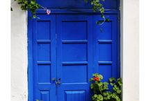 """Blue Doors / Our team will always hold a special place in our hearts for doors, especially blue doors. One could say it is because """"we open doors to possibilities and provide the keys to success,"""" the truth is ... our founder has a blue door on her house. This door has become our namesake."""