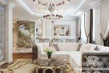 Дизайн квартиры в классическом стиле с белой мебелью на Профсоюзной / Дизайн-проект разработан для квартиры на Профсоюзной и выполнен в классическом стиле. Всего имеется несколько помещений: гостиная, уютная спальня, просторная кухня, отдельная прачечная и ванная комната.  Интерьер дома включает в себя стилистически выверенный декор, который сохраняет гармонию композиции.