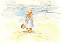 Meisje op strand met hoedje