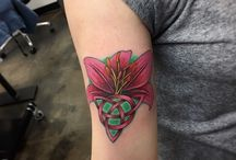 Lily Tattoos / Lily flower tattoo design signifies spiritual enlightenment and purity.... more at http://fabulousdesign.net/lily-tattoos-meanigns/