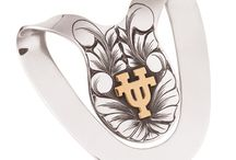 University of Texas Licensed Products / Great products officially licensed by the University of Texas.  A portion of the proceeds from each sale goes to support programs at the University.  All sterling silver and 14kt gold items are only available at Rewards.