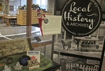 Adventures of Archives Elf / Hamilton Public Library's Local History & Archives Department featured the different resources, services, and collections in the department with help from an Elf on a Shelf, Happy (our own #ArchivesElf).