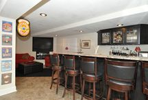 Lower Level Remodel / Lower level build out where entertaining was at the top of this clients list. With the design including a custom built painted bar, custom built in T.V. separate laundry room and open floor plan completed this lower level just in time for Christmas.