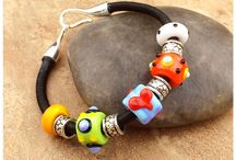 Jewelry - Bracelets / A collection of bracelets created by talented jewelry artists from various materials including lampwork glass beads, gems, metals, cord and leathers. #artiseverywhere