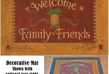 Under Foot: Door Mats & Rugs / We carry Door Mats, decorative Floor Mats and Briaded Rugs and more.