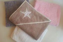 Canastilla artesanal / Artículos para dar la bienvenida al bebé y acompañarlo en sus primeros años. Arrullos, cambiadores, neceseres, capas de baño...