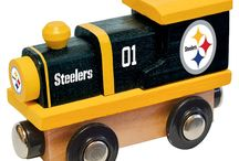 NFL Wood Toy Trains / Shop our collection of NFL football themed wooden toy trains. All of the major teams carriered including Colts, Patriots, Saints, Ravens, Giants and more.