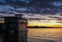 """River Boat Safari / This is quite a unique river boat safari because it takes place on the Olifants river bordering the Kruger National Park in Big Five teratory. It is 20km from the closest town so it is pretty much in the wild. It is a large """"two storey"""" boat so that you can get some nice height to view the banks as you drive down the river.  The river has pods of hippo and sightings of giraffe, lion, various types of buck, elephant and buffalo are common."""