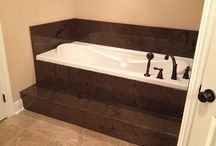 Tub countertops / Granite, marble, and other materials used around the tubs.
