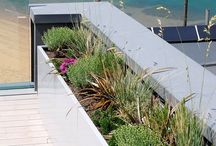 Beachfront Residence | Our Work / Commissioned by IOTA. A selection of large bespoke steel planters were commissioned for this prestigious beachfront residence on the South Coast of England.  A total of 12 large planters were commissioned, in sizes up to 3000mm, and in various geometric forms. Given the extreme coastal location, the planters were fabricated from 1.5mm thick 316 [marine] grade steel, powder coated (one of the planters, in a purely functional area, was hot dipped galvanised to marine spec.)