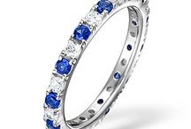 Sapphire Eternity Rings / A splendid circle of sparkling diamonds and sapphires, an eternity ring is more than just a ring. Our bespoke collection of beautifully designed platinum and gold eternity rings is the perfect way to say you'll love her forever...
