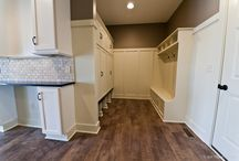 Mudrooms & Drop Spots / Come home and drop your shoes, backpack, purse, keys, and anything else in your custom foyer with mudroom built-in shelves and a drop spot