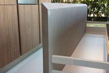 Bancone / Rivestimento in resina cemento e inox