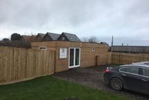 Gwel an Mor - Sales Office - Portreath / Gwel existing cement board finish sales office, undergoes a contemporary revamp using Thermowood D. Cladding vertical and horizontal to match the luxury Eco Lodges. Roof trim detail and boxing in of drain completes the project.