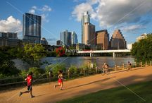 Lady Bird Lake Hike & Bike Running Trail for walking, running and biking - Stock Photo Image Gallery / Lady Bird Lake Hike and Bike Trail is 10 miles of trails that border Lady Bird Lake in downtown Austin and serve as a social hub for runners, walkers and cyclists. A memorial at Auditorium Shores honors the late bluesman Stevie Ray Vaughan. The Ann and Roy Butler Pedestrian Bridge crosses Lady Bird Lake between W. Cesar Chavez St. and W. Riverside Dr.