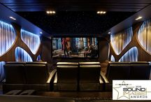 Utopian Realm / Home theatre and bar in Melbourne VIC Australia designed by Wavetrain Cinemas. Seating by Fortress Seating. Carpet by Tsar.