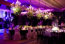 Four Seasons San Francisco / Featuring full drapery & custom lighting design by Enhanced Lighting.  White chiffon drapery + lighting elements were featured in the cocktail area. Enhanced hung all the floral pieces. The ballroom was completely draped with custom egg plant taffeta, all the tables were lit & egg plant uplighting accented the lush drapery.  Enhanced hung 5 stunning chandeliers over the kings table, + an artistic pattern overlay on the dance floor. A cluster of 4 foot crystal chandeliers framed the dance floor.