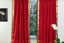 Red Curtains and Window treatments in the interiors living room / Red Curtains and Window treatments in the interiors living room