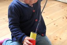 Threading activity for toddlers using DIY cardboard tube beads and pipe cleaners